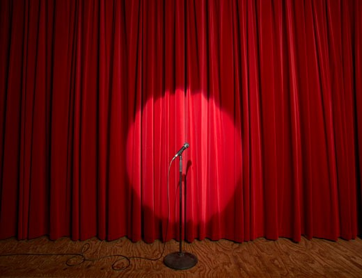 Microphone in spotlight on a stage